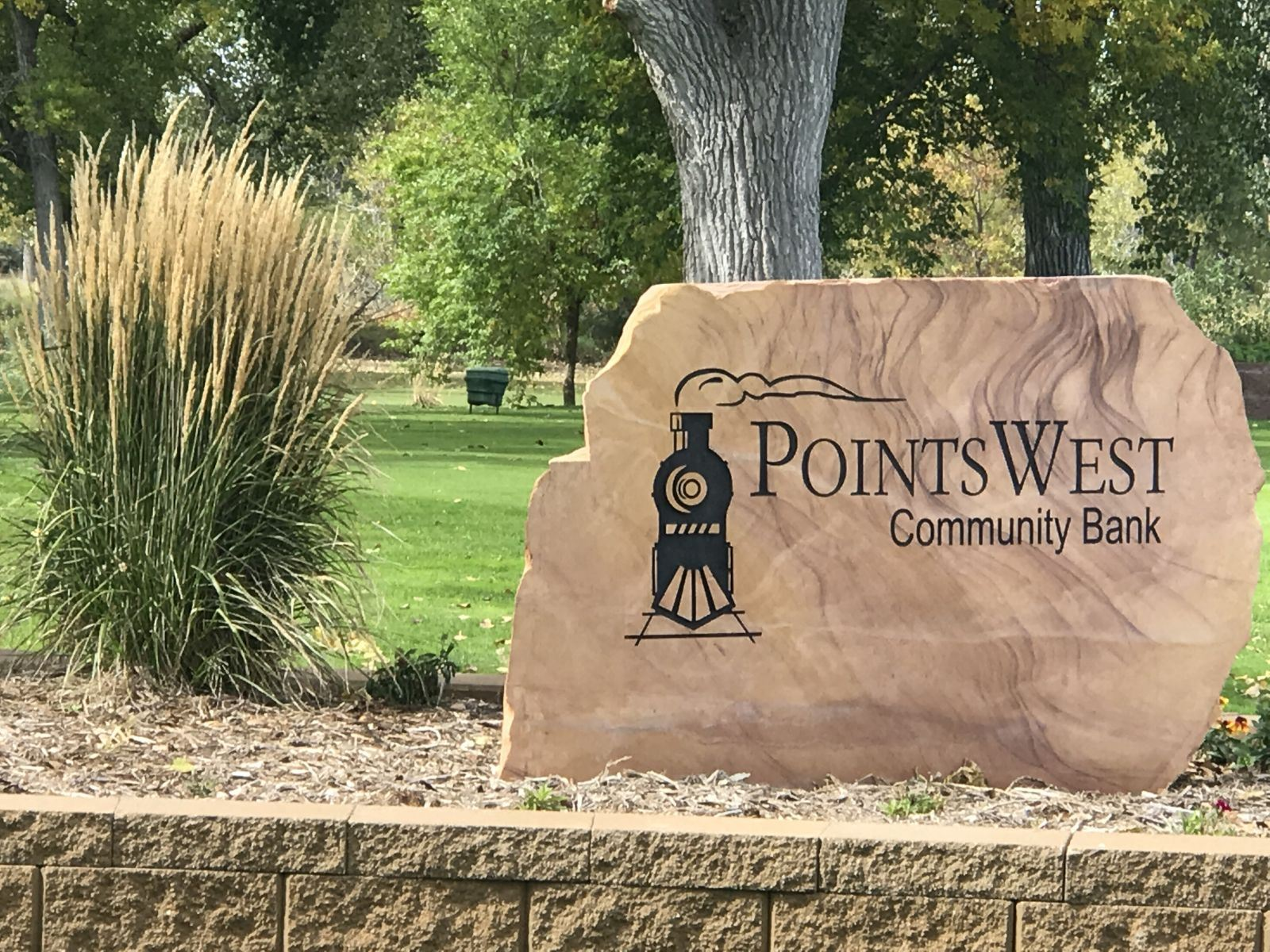 Points West Community Bank Stone Sign in Planter Box